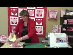 """http://www.MissouriQuiltCo.com - Jenny Doan teaches how to make easy hearts out of charm squares (5"""" squares) and Layer Cakes (10"""" Squares) Give it a shot, it couldn't be easier!!  To see the best selection of charm packs and layer cakes on the web, follow the links below:    Charm Packs  http://www.missouriquiltco.com/shop/browse/12    Layer Cakes  h..."""