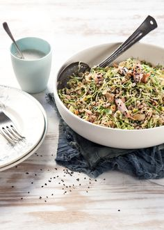 Farro and yellow pea salad with spinach and flaked  salmon,white bean and black sesame dressing