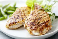 Combine olive oil, ¼ cup of lemon juice, ¼ cup of white vinegar, and 1 tablespoon each of dried parsley and basil. Add in a ½ teaspoon of dried oregano, garlic powder, salt, cracked black pepper, and a dash of chopped garlic. Toss a pound of chicken breasts into the marinade for at least 10 stuffed minutes, and then grill or bake in the oven at 425 degrees for 15 minutes or until juices run clear