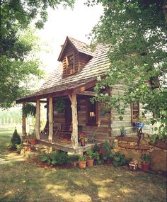 Bob Timberlake Guest House and Studio - how cute is this tiny log cabin with red accents?