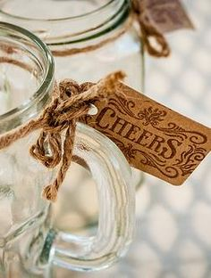 Vintage rustic look tags--old country font amd traditional swirls with brown paper and twine.