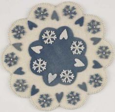 You don't even need a sewing machine to make this charming wool table appliqué centerpiece.