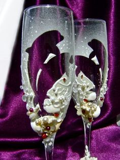 Beach wedding toasting flutes with dolphins and corals