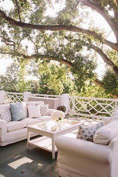 Country club wedding reception wuth couches and blue and white details | Abby Jiu | Brides.com