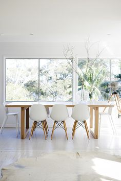 love clean white/wood dining rooms
