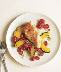 Chicken With Acorn Squash and Tomatoes | Get the recipe: http://www.realsimple.com/food-recipes/browse-all-recipes/chicken-acorn-squash-tomatoes-00000000044728/