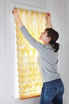 Craft a privacy shade: Cut paper to your window's width and its length plus 2 feet, and fold accordian-style.