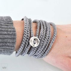 Easy bracelet, single chain crochet-- about 4.5 ft long, or enough to wrap your wrist 9 times.