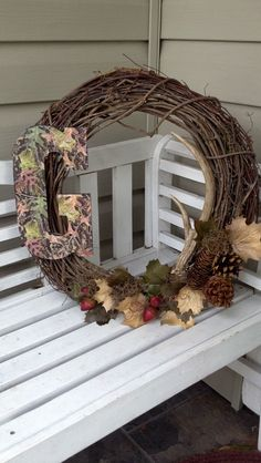 @Teresa Latham  lets make these for our doors!!! Camo Letter Wreath with Deer Antler and foliage