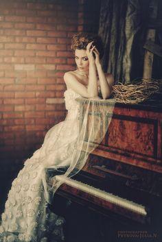 Piano and dress and bricks, love it.