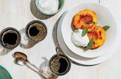 Brûléed Peaches With Vanilla Bean Whipped Cream and Basil | Vanilla beans are classic, but for a richer flavor, try 1 tbsp bourbon vanilla bean paste instead.