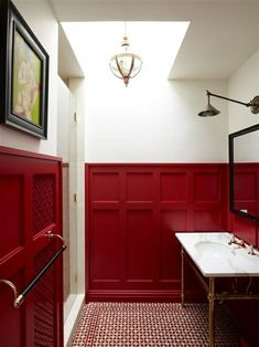 Red wainscoting. Designed by Sarah Story in NYC. The floor tile is amazing!
