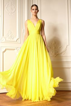 Yellow. Love the flow of the gown