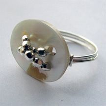 I have some of my Grandma's buttons you could use to do this.  Button Wire Jewelry Ideas