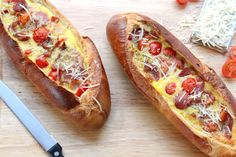 Into a bread boat with bacon and tomatoes.