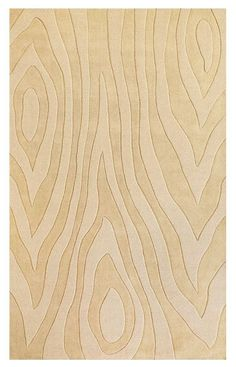 This ivory wool area rug has just enough movement to form an interesting foundation for a room.