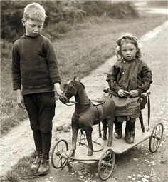 Boy and Girl w Wooden Horse Toy