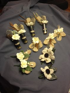 The actual boutonnieres that my Mother-in-Law made for the men, ushers, and pastor. Feathers, shotgun shells, burlap. Love them!