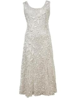 An ivory plus size dress with luxury lace available in sizes 10 to 24