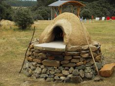 Building a Cob Oven - Step-by-step photo illustrated #howto guide on building a clay oven. Timothy plans to build one of these in the backyard. idea, yard, cob oven, house building, outdoor oven, pizza party, pizza ovens, cob houses, grid live