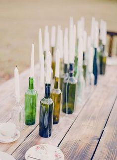 Use colorful old bottles and taper candles to create a wow-worthy centerpiece!