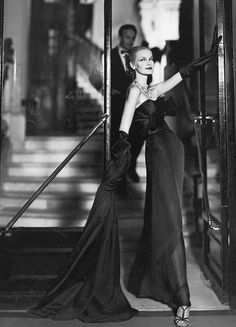 Sunny Harnett in evening dress by Lanvin-Castillo, photographed by Avedon at the Hotel San Règis, Paris, August 1954.