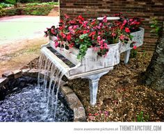 Old Piano Turned Into Outdoor Fountain
