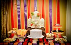 Arabian Nights Birthday Party - I love the ribbon backdrop that extends onto the table, the ruffle cake, and the fruit skewers.