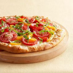 This classic pizza recipe is stacked high with veggies -- roma tomatoes, spinach, and peppers: http://www.bhg.com/recipes/quick-easy/dinners-30-minutes-less/30-minute-heart-healthy-dinner-recipes/?socsrc=bhgpin041314cheesyredpepperpizza&page=18