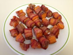 Paleo Appetizer! Sweet potatoes wrapped in bacon. Served with BBQ sauce.