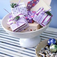 These tiny #gifts are wrapped in a host of coordinating scrapbook papers. More wrapping inspiration: http://www.bhg.com/christmas/gift-wrapping/pretty-gift-wraps-and-bows/