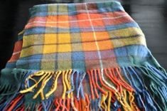 Scottish plaid shawl. Article at http://www.buckettripper.com/what-to-buy-in-scotland-souvenirs-in-the-land-of-whisky-and-bagpipes/ souvenir