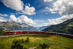 Bernina Express between Chur and Tirano (Switzerland & Italy).  'Relax behind panorama windows and soak up the spectacular Alpine views connecting northern and southern Europe. The route follows two World Heritage–listed lines, the Albula and the Bernina, and sweeps among glaciers in Switzerland and palms in Italy. Don't miss chic, lakeside St Moritz.' http://www.lonelyplanet.com/switzerland