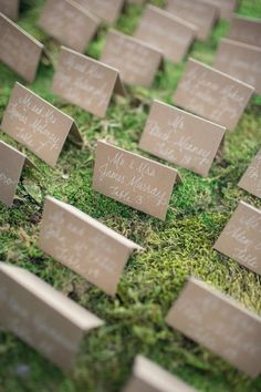 craft paper and white calligraphy escort cards