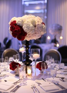 Red & White Centerpieces // Photo: Esther Sun Photography // TheKnot.com