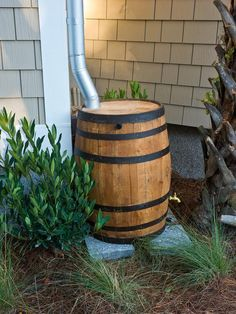 Rain barrels collect runoff for landscape irrigation. HGTV Smart Home >> http://www.hgtv.com/smart-home/hgtv-smart-home-2013-garage-exterior-pictures/pictures/page-10.html?soc=pinterest