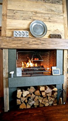 kitchen fireplace.  Great place to store the wood.