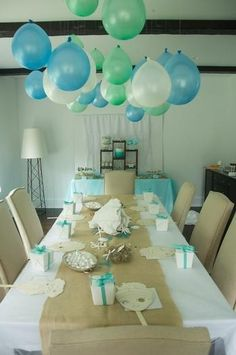 Balloons in the air. Upside down from the ceiling like cool modern chandeliers. Easy, Great alternative to Helium