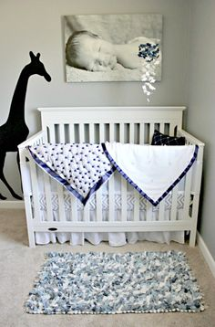 This black #giraffe #decal is a super cool accent in a #gray & #white #nursery.