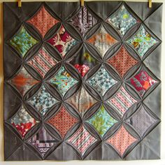 Mmmm, orange on gray. The full blog post linked on flickr tells me that a bed-size cathedral window quilt needs on the order of 35 yards of the background solid. Wow. Good to know.
