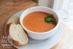 Slow cooker tomato basil parmesan soup from The Baker Upstairs. This rich and delicious soup is so easy to make! The perfect comfort food meal! www.thebakerupstairs.com