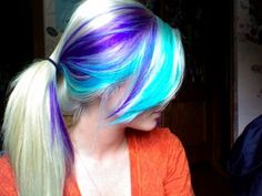 blue and blonde hair | This hair in white blonde with bright turquoise and purple streaks is ...