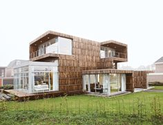 "This Sleek, Comfy Home? Yeah, It's Made of Recycled Trash  Clad in wood stripped from 600 dismantled cable reels and outfitted in kitchen cabinets made of billboards, Villa Welpeloo is a ""super-recycled"" house by the Rotterdam-based firm Superuse Studios.  According to one of the architects, Jan Jongert, reused materials account for 60 percent of the house's structure and as much as 90 percent of the furnishings and hardware inside."