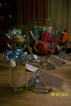 """Great baby shower hostess gift... """"Thank You for being a hostess. I hope you enjoy some of my mom's favorite things."""" Wine glass with some of your favorite items and a mini wine :)"""