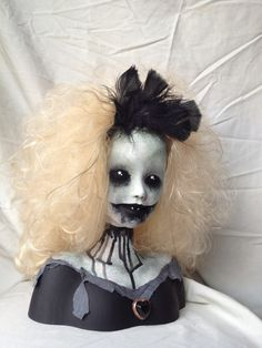 They took one of those Barbie Heads where kids get to do the hair and make it wicked.  Wicked....