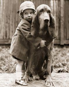 Girl and big hound dog