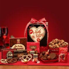 """Hugs Kisses    Send your """"Hugs and Kisses"""" to your special someone this year. Your Valentine will certainly know how much you love them when they see this adorable Hugs and Kisses gift box filled with what else? Why chocolate of course! SHOP NOW: www.KimsLabellabaskets.com"""