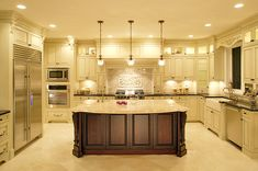 a bit stately, but soooo beautiful  sink, dwasher, hood, appliance wall, dark island, beautiful backsplash