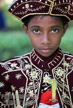 Sri Lankan boy in traditional Sri Lankan dress