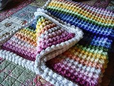I love the texture of this blanket! It's a simple stitch of a triple crochet in one stitch, followed by a single crochet in the next stitch. Who would have thought?. crochet blankets, afghan, color patterns, crocheted blankets, crochet stitches, blanket patterns, crochet patterns, rainbow, stitch patterns